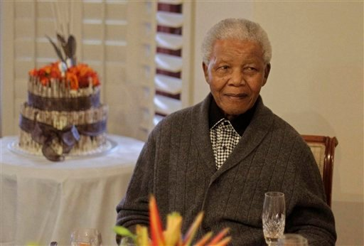 """Former South African President Nelson Mandela celebrates his 94th birthday with family in Qunu, South Africa, on July 18. Mandela was taken to a hospital Saturday to be treated for a recurrence of a lung infection and is in """"serious but stable"""" condition, the president's office said."""
