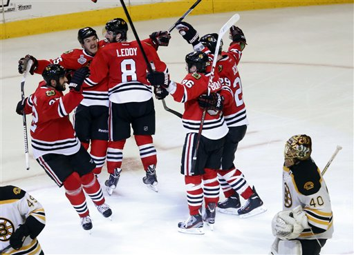 Chicago Blackhawks center Andrew Shaw, second from left, celebrates with his teammates after scoring the winning goal during the third overtime period of Game 1 in their NHL Stanley Cup Final hockey series against the Boston Bruins, Thursday, June 13, 2013, in Chicago. The Blackhawks won 4-3. (AP Photo/Charles Rex Arbogast) United Center