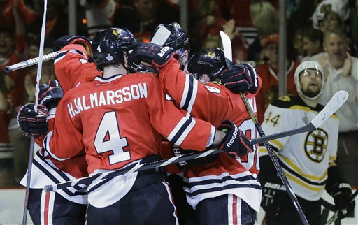 The Chicago Blackhawks celebrate a second period goal against the Boston Bruins during Game 5 of the Stanley Cup Finals on Saturday in Chicago. The Blackhawks won 3-1, and have a 3-2 series lead.