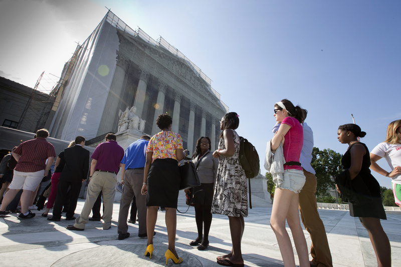Visitors wait outside the Supreme Court in Washington on Thursday in anticipation of key decisions being announced.