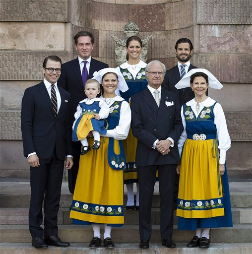 The Swedish Royal family, from left to right, Prince Daniel, Chris O'Neill, Princess Estelle, Crown Princess Victoria, Princess Madeleine, King Carl Gustaf, Prince Carl Philip and Queen Silvia pose for a family photo during the Swedish National Day celebrations at the Royal Palace in Stockholm on Thursday.