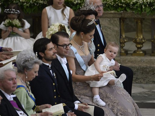 From right, Sweden's King Carl Gustaf, Queen Silvia, Crown Princess Victoria with Princess Estelle, Prince Daniel and Prince Carl Philip attend the wedding ceremony of Princess Madeleine and Christopher O'Neill at the Royal Chapel in Stockholm on Saturday.