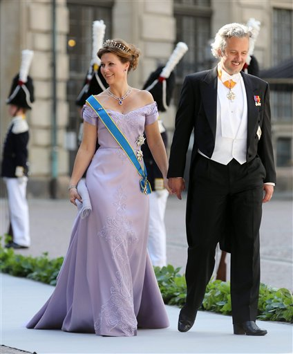 Princess Martha Louise of Norway with her husband, Ari Behn, arrive at the Royal Chapel before the wedding of Sweden's Princess Madeleine and Christopher O'Neill, in Stockholm on Saturday.