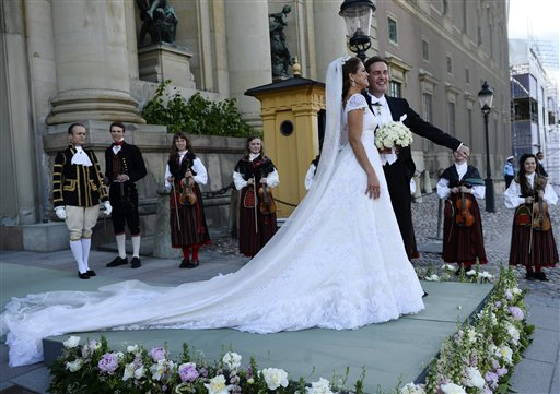 Princess Madeleine and her husband, Christopher O'Neill, stand outside the Royal Chapel after the irwedding ceremony in Stockholm on Saturday.