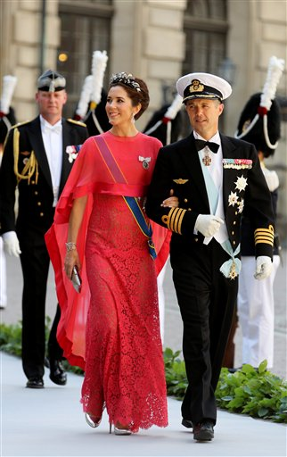 Crown Prince Frederik and Crown Princess Mary of Denmark arrive at the Royal Chapel for the wedding of Sweden's Princess Madeleine and Christopher O'Neill, in Stockholm on Saturday.