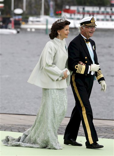 Queen Silvia and King Carl Gustaf of Sweden leave for a boat trip to Drottningholms Castle after the wedding ceremony of Princess Madeleine of Sweden and Christopher O'Neill at the royal chapel in Stockholm on Saturday.