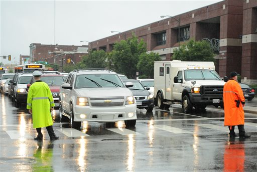Police officers direct traffic next to the Stuart C. Siegel Center at Virginia Commonwealth University in Richmond, Va. on Friday. Tropical Storm Andrea doused the area with ample rainfall as the arena hosted graduations for local high schools.