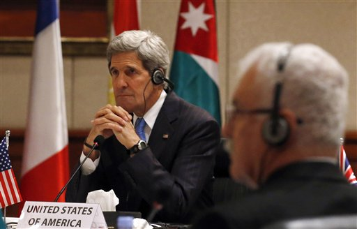 U.S. Secretary of State John Kerry and President of Syrian Opposition Coalition George Sabra attend a meeting in Amman, Jordan, on May 22.