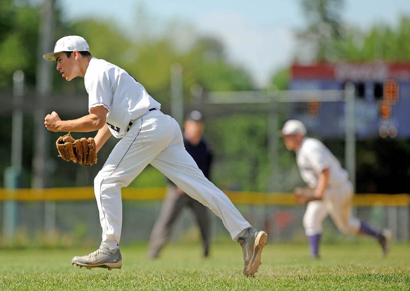 PSYCHED: Waterville Senior High School pitcher Brian Bellows, left, celebrates a strikeout against Presque Isle High School in an Eastern Maine Class B prelim game on Tuesday in Waterville. Waterville defeated Presque Isle 4-1.
