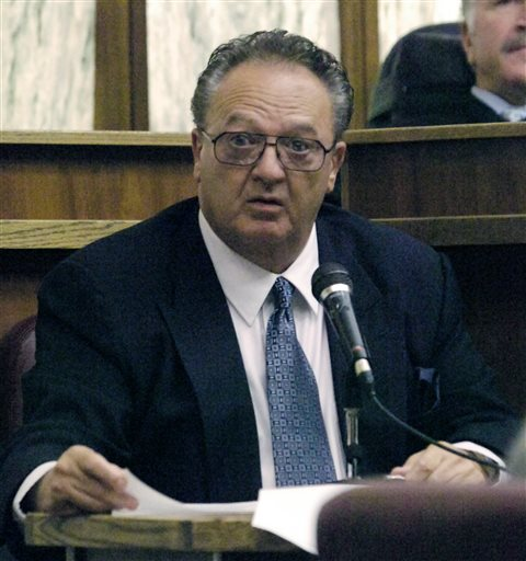 """In this Sept. 17, 2008, photo, John Martorano is questioned in a Miami courtroom about his plea agreement in exchange for testifying against former FBI agent John Connolly. Connolly was accused of helping the Boston mob murder Miami gambling executive John Callahan in 1982 at Miami International Airport. Martorano will be on the witness stand Monday to testify at the trial of James """"Whitey"""" Bulger."""