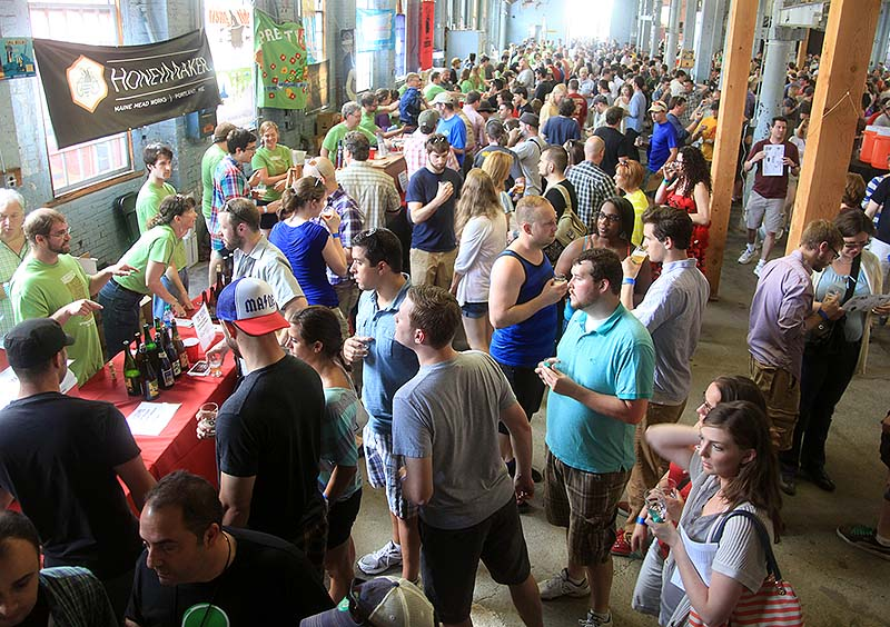 A large crowd, which included tourists and brewers from all over the world, gathers at The Festival at The Portland Company on Saturday, June 22, 2013. The owner of Shelton Bros. says he lost money on the popular weekend event and says state liquor laws need updating or The Festival won't come back to Maine.