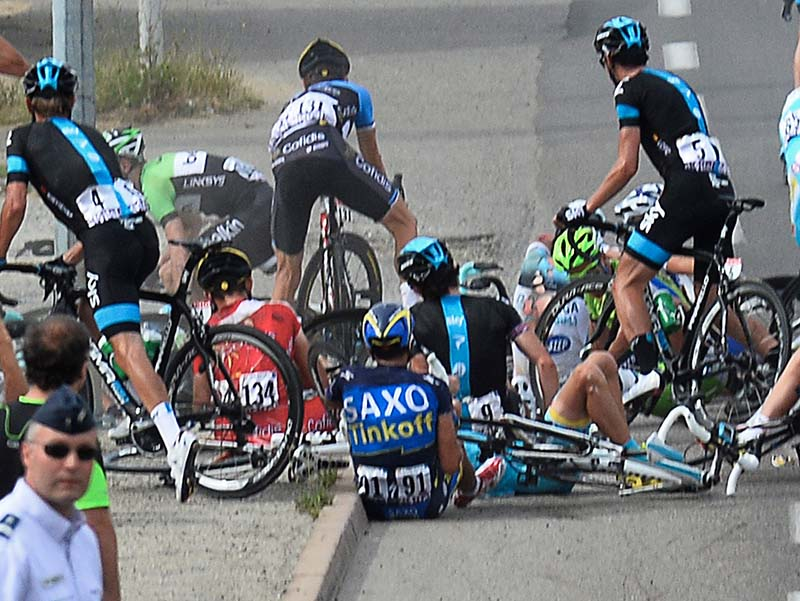 Alberto Contador of Spain, center with number 91, sits on the road after a group of riders crashed during the first stage of the Tour de France cycling race on Saturday.