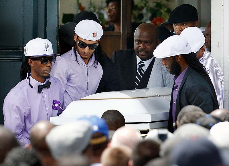 Pallbearers carry the casket of Odin LLoyd following a funeral ceremony at the Church of the Holy Spirit in Boston in Boston on Saturday. Hundreds of relatives, friends and well-wishers wept together and hugged at the funeral for LLoyd, a semi-pro football player whose killing led to murder and weapons charges against former New England Patriots player Aaron Hernandez.