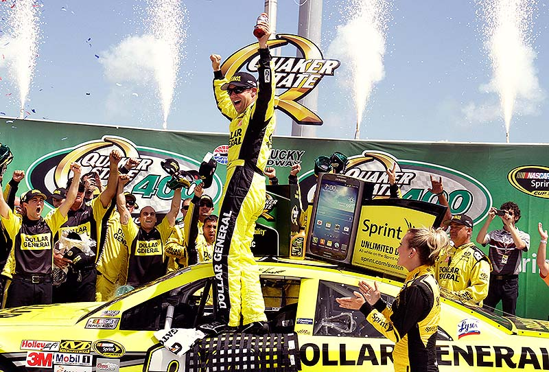 Matt Kenseth celebrates with his crew members after capturing the NASCAR Sprint Cup auto race at Kentucky Speedway in Sparta, Ky., on Sunday.