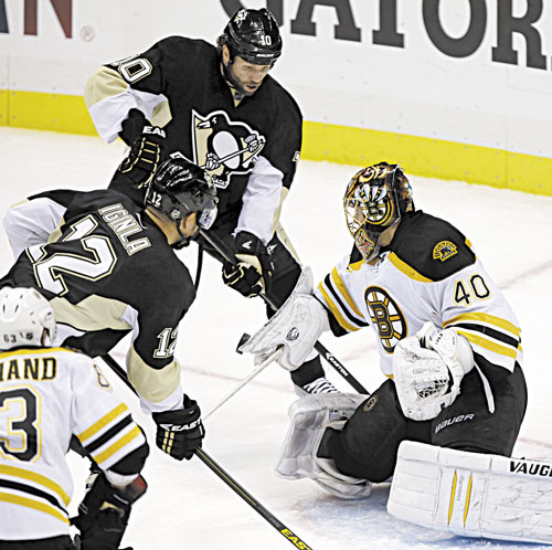 WALL: Boston Bruins goalie Tuukka Rask (40) blocks a shot in front of Pittsburgh's Brenden Morrow (10) and Jarome Iginla (12) during Game 2 of the Eastern Conference finals Monday in Pittsburgh. Rask has stopped 55 of 56 shots in the series.