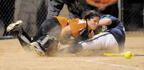 Gardiner catcher Steph Plourde, left, drops the ball in a collision with Oceanside's Kannadi Grover in the sixth inning of the Eastern Class B regional final Thursday at Brewer High School.