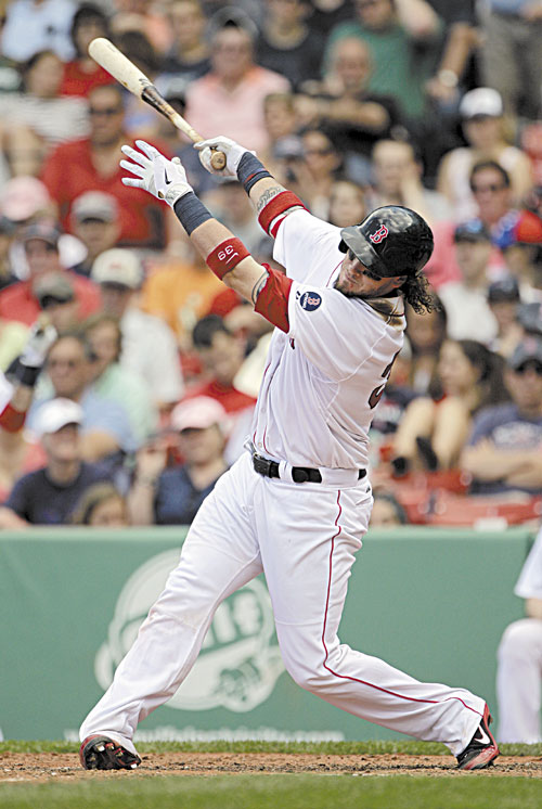 1ST OF TWO: Boston's Jarrod Saltalamacchia follows through on a home run during the sixth inning against the Los Angeles Angels on Sunday at Fenway Park in Boston. Saltalamacchia hit two home runs in the Red Sox 10-5 win.