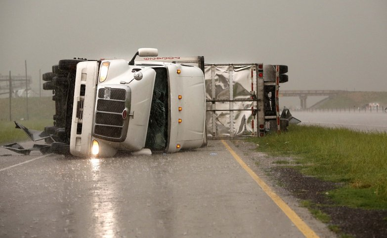 Overturned trucks block a frontage road off I-40 just east of 81 in El Reno, Okla., after a tornado moved through the area on Friday.