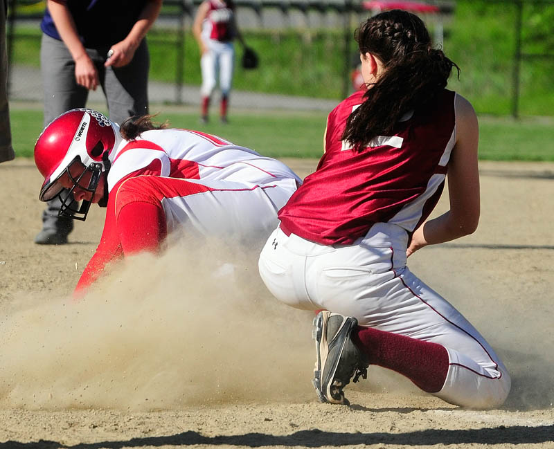 Staff photo by Joe Phelan Cony's Kassidy Turgeon, left, is safely on third base before Bangor's shortstop Syndi Cosgrove can apply tag during a game on Wednesday June 5, 2013 at Cony Family Field in Augusta.