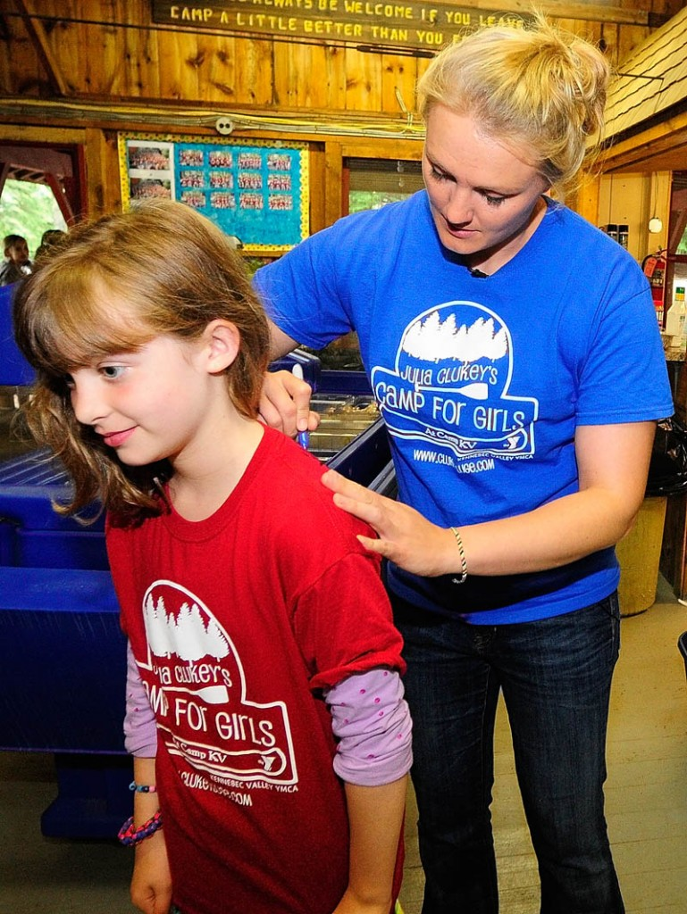 A SIGNATURE MOMENT: Emily Curtis of Brunswick gets an autograph on the back of her camp shirt from Julia Clukey on Thursday at Julia Clukey's Camp for Girls at Camp KV in Readfield.