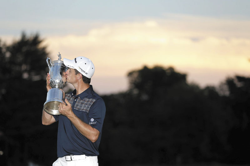 WORTHY OF A KISS: Justin Rose, of England, kisses the trophy after winning the U.S. Open on Sunday at Merion Golf Club, Sunday in Ardmore, Pa.