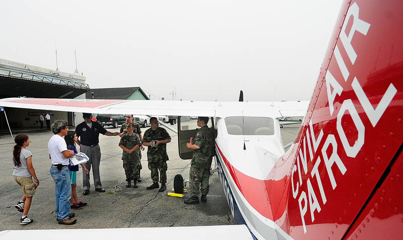 People look at one of the planes on display during an open house at the Civil Air Patrol hangar on Saturday at the Augusta State Airport.