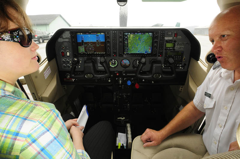 Courtney Oliver, 21 of Winthrop, left, sits in an airplane cockpit and learns about joining the Civil Air Patrol from Civil AIr Patrol Capt. Steve Vorpagel on Saturday at the Augusta State Airport.