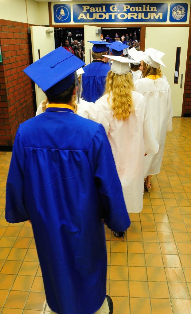 Graduates file into the Paul G. Poulin Auditorium at the start of Erskine Academy's commencement on Friday at the Augusta Civic Center.