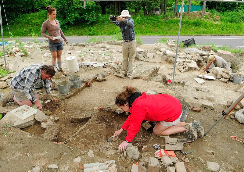 Leith Smith, chief archeologist with the Maine Historic Preservation Commission, photographs a section of the archeological dig on Tuesday at the Fort RIchmond site, near the Kennebec River in RIchmond.