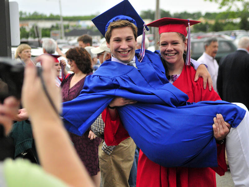 Collin Fosnough, left, poses for a photo with class mate Kaitlyn Davis holding him before Messalonskee graduation on Thursday at the Augusta Civic Center.