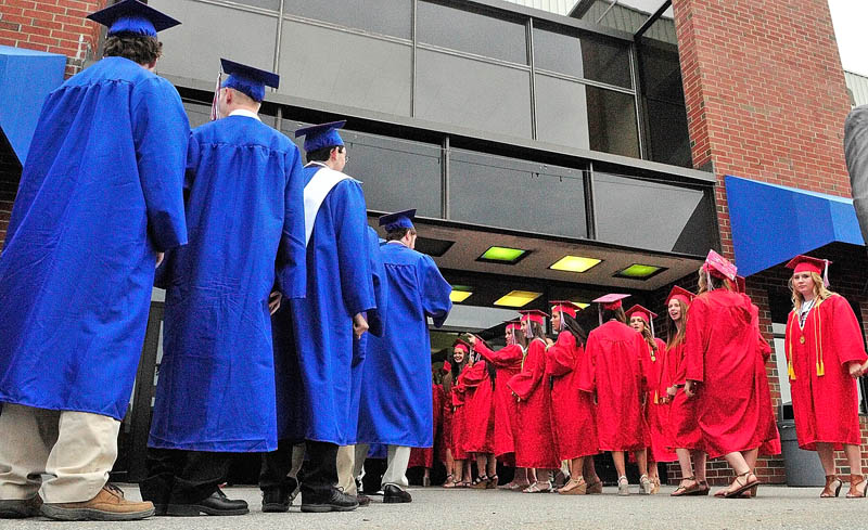 Students march into the building at the start of Messalonskee graduation on Thursday at the Augusta Civic Center.