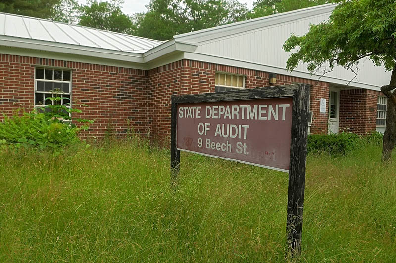 Tall grass grows around the former Department of Audit office, in the Stevens School complex, on Friday in Hallowell.
