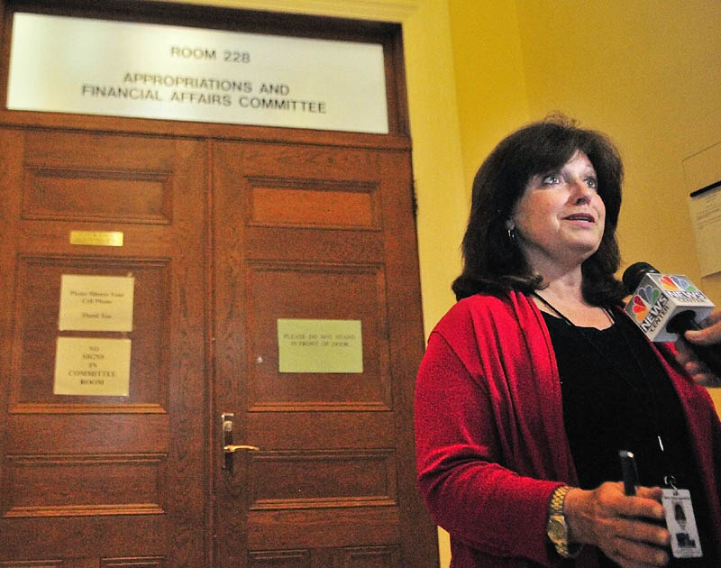 Co-chair Sen. Dawn Hill, D-Cape Neddick, talks to reporters outside the Appropriations Committee room on Friday at the State House in Augusta.