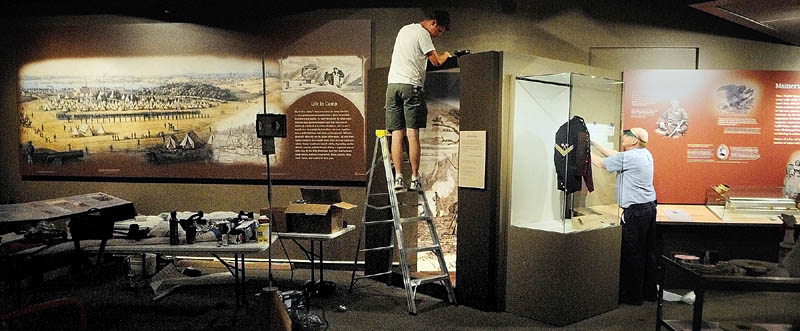 "James Flachsbart, left, and Don Bassett work on the exhibit titled ""Maine Voices from the Civil War"" on Wednesday at the Maine State Museum in Augusta."