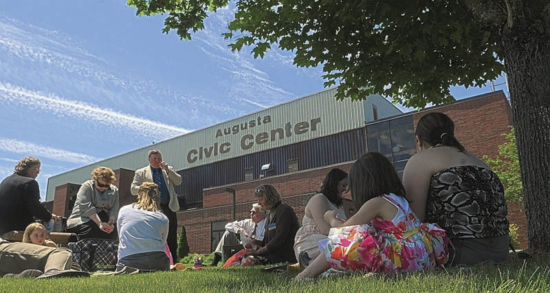 People enjoy an outdoor lunch break during the Jehovah's Witnesses district convention on Friday at the Augusta Civic Center.