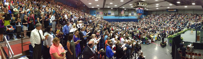 People sing a hymn during a Jehovah's Witnesses district convention on Friday at the Augusta Civic Center.