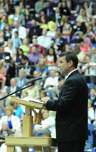 Aaron Moone speaks from the stage during a Jehovah's Witnesses district convention on Friday at the Augusta Civic Center.