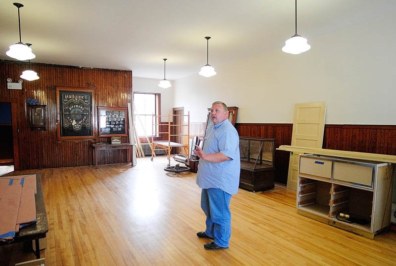 Assistant Fire Chief Jeff Thompson discusses renovations in the meeting room at the Hallowell Fire Station on Tuesday.