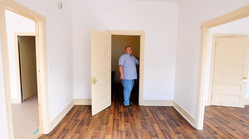 Assistant Fire Chief Jeff Thompson discusses renovations in the second-floor apartment at the Hallowell Fire Station on Tuesday.