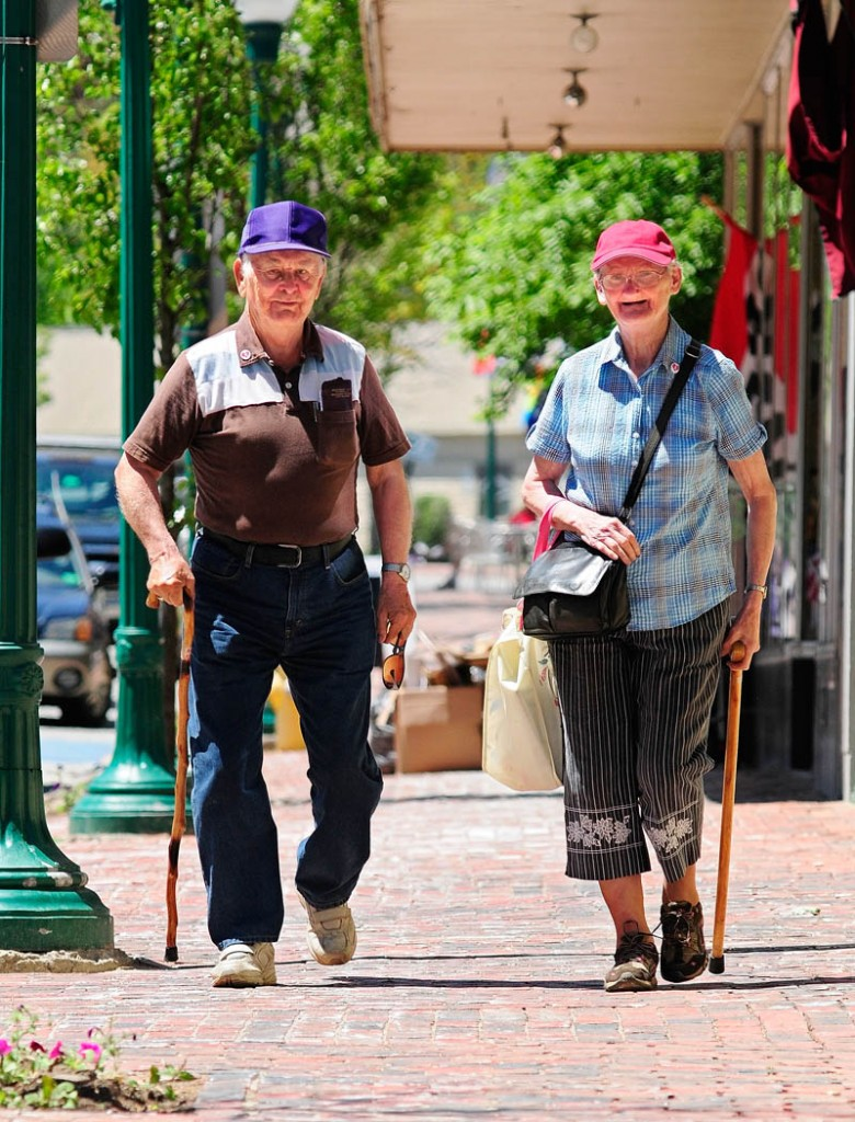 Albert and Elizabeth Conary walk down Water Street on Wednesday in downtown Gardiner. The couple has been married 41 years and most days they walk around the downtown district.