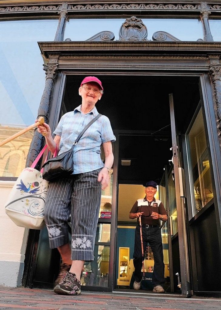 Elizabeth and Albert Conary leave Camden National Bank in Gardiner on Wednesday.