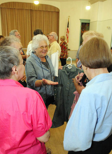 Brenda Boutilier Deojay, center, brought her old Girl Scouts uniform to a reunion of one-room schoolhouse alumni, on Friday at Asa Gile Hall in Readfield.