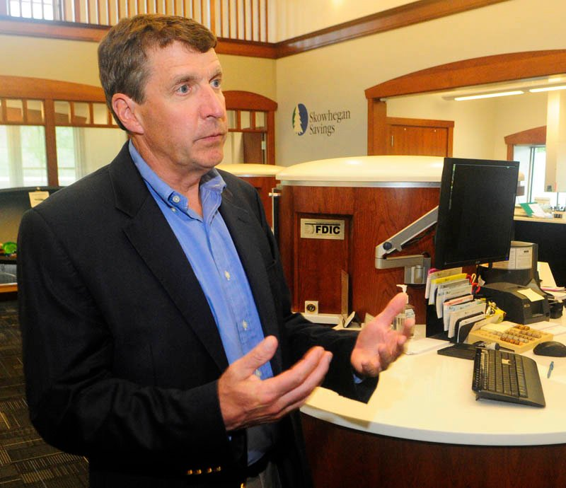 President John Witherspoon talks about Skowhegan Savings' new dialog banking system on Friday in the bank's new branch on Route 27 in Augusta.