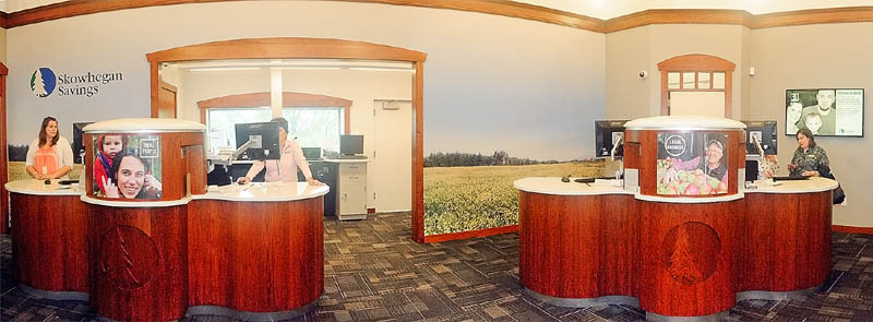 Tellers working behind two pods are seen in the lobby of the new Skowhegan Savings branch on Friday in Augusta.