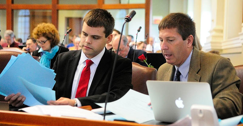 Assistant House Republican leader Rep. Alexander Willette, R-Mapleton, left, and Republican Leader Kenneth Fredette, R-Newport, confer as the House votes during a session on Wednesday in the State House in Augusta.