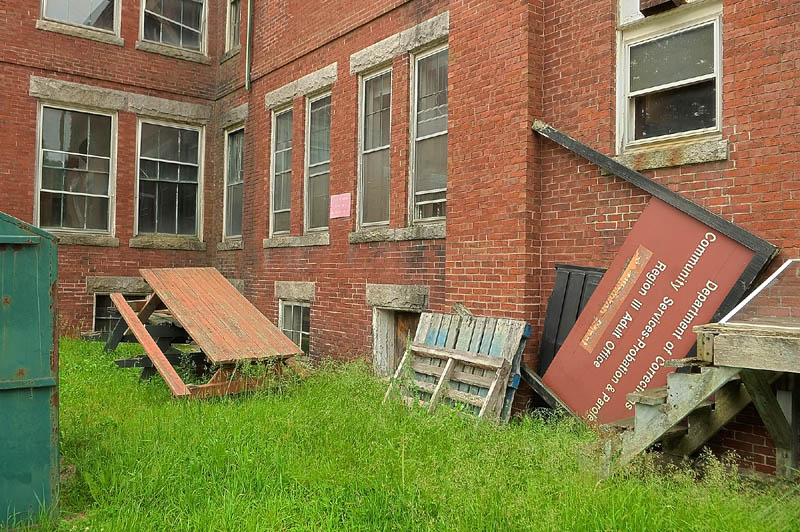 Broken picnic tables and signs are stored behind 7 Beech St., in the old Stevens School complex, on Friday in Hallowell.