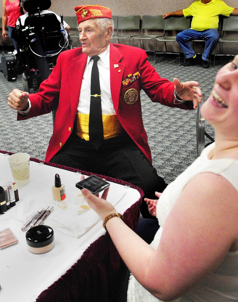 Makeup artist Kathryn Raymond, right, laughs as Leroy Peasley jokes around after she finished his makeup on Friday, before the VA Maine Healthcare Systems-Togus' Creative Arts Festival at the Augusta Civic Center. Peasley, an 89-year-old Marine veteran of World War II from Rockland, was going to read a poem and sing a song during his three-minute slot in the show.
