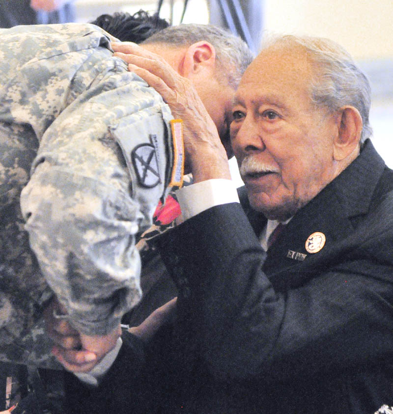 Maine Army National Guard Lt. Col. Jeffery Bilodeau, left, visits with Don Lucero before he was presented with the Bronze Star for bravery, the Purple Heart for suffering injury and the New Mexico Bataan Service Medal.