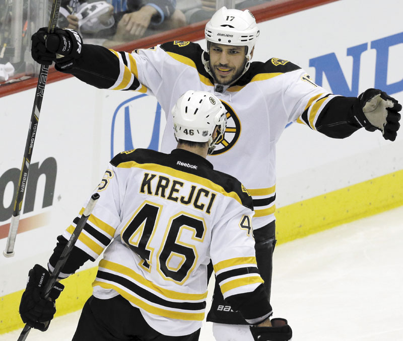 AP photo BIG GAME PLAYER: Boston Bruins' David Krejci (46) celebrates his second goal of the game with teammate Milan Lucic in the third period of Game 1 of the Eastern Conference finals against the Pittsburgh Penguins. Krejci has nine goals and 21 points to lead the NHL in the postseason.