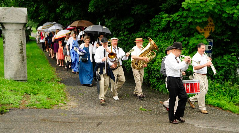 Mel Tukey's Jazz Society Orchestra leads the funeral party out of Forest Grove cemetery, following services for Charles Andrews on Saturday in Augusta.